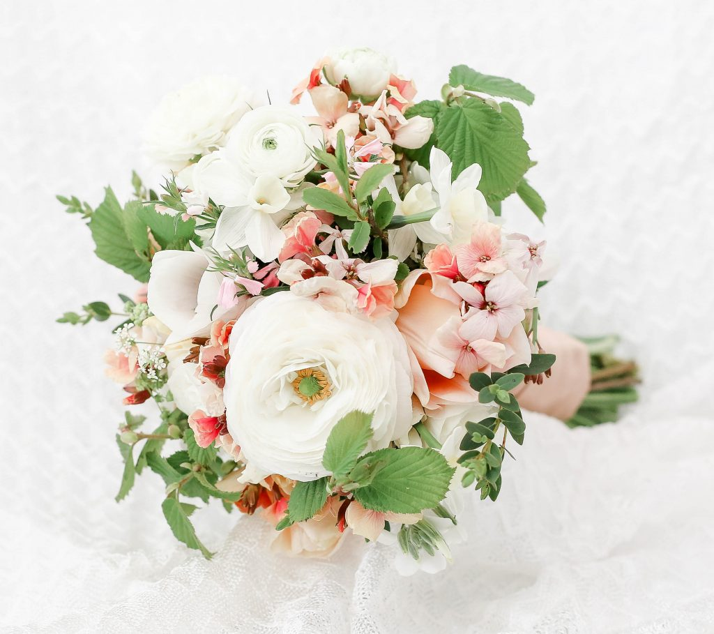 Peach and cream flowers bridal bouquet bridesmaid posy Cheltenham wedding